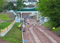 The points at the northern end of the double track Gorebridge - Tynehead section of the Borders Railway. Long lens view north from Fushiebridge on 29 May 2015, with Gorebridge station just beyond Lady Brae road bridge in the left background. Note also the new pedestrian footbridge (not yet open). <br><br>[John Furnevel&nbsp;29/05/2015]