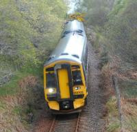 158702 southbound towards Inverness on 16 May about to go under the A9 at The Mound alongside the River Fleet. The train is the 1234 ScotRail service from Wick / Thurso.<br><br>[Brian Smith&nbsp;16/05/2015]
