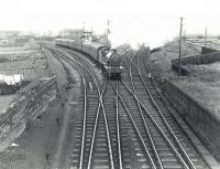 40668 shortly after leaving Ardrossan Town on 6 July 1959 about to run through Holm Junction with a train for St Enoch. The locomotive has just passed its home shed standing in the V of the junction. The Largs route runs off to the right.<br><br>[G H Robin collection by courtesy of the Mitchell Library, Glasgow&nbsp;06/07/1959]