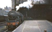Black 5 44952 awaiting its departure time at Edinburgh's Princes Street station on 24 July 1964 with a train for Carstairs.<br><br>[John Robin&nbsp;24/07/1964]