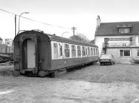 A Mk1 coach at the rear of the Leadburn Inn awaiting conversion to a dining car in April 1985.  The Inn, located opposite the site of Leadburn station on the A6094,  burned down in 2005 and was rebuilt in 2010. The coach survived the fire although its current whereabouts are unknown.<br><br> Note from Alastair Taylor:<br><br> According to the Vintage Carriages Trust website, this TSO was originally M4427 and was scrapped (presumably on site) in 2006.<br><br>[Bill Roberton&nbsp;07/04/1985]