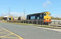 DRS 20309 leads two flask wagons and classmate 20305 along the spur to the power station that leads off the main Heysham Port branch. The train is running alongside the road to the IOMSP ferry terminal on 26th May 2015. <br><br>[Mark Bartlett&nbsp;26/05/2015]