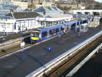 A bright and sunny morning at Stirling station platform 9 on 1 April 2015 sees the 0836 Alloa - Glasgow Queen Street marking time during its scheduled 8 minute stopover here, following a 9 minute journey from Alloa.<br><br>[John Furnevel&nbsp;01/04/2015]