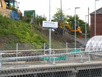 Work underway on the steps which will provide a pedestrian link between the A7 and the new Borders Railway station at Newtongrange. Looking south east across the line on 3 June 2015.<br><br>[John Furnevel&nbsp;03/06/2015]