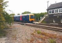 An up First Great Western 'Thames Turbo' DMU accelerates past the signal box at Moreton-in-Marsh on 23rd May 2015 on its way to Paddington. [See image 35794]<br><br>[Ken Strachan&nbsp;23/05/2015]