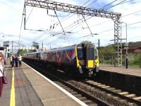 The 0907 Glasgow Central - Manchester Airport arrives at Lockerbie on 4 June 2015.<br><br>[Bruce McCartney&nbsp;04/06/2015]