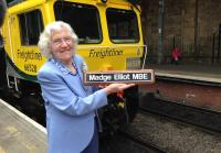 Naming ceremony at Waverley station on 4 June 2015. Freightliner 66528 <I>Madge Elliot MBE</I> with the lady herself. [See news item]<br><br>[Bruce McCartney&nbsp;04/06/2015]