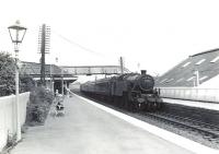 Fairburn 2-6-4T 42202 arrives at Kilwinning on 4 July 1959 with a Glasgow St Enoch - Ayr train.<br><br>[G H Robin collection by courtesy of the Mitchell Library, Glasgow&nbsp;04/07/1959]