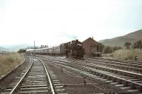 Black 5 44828 with a down express passing Elvanfoot on 30 July 1966. The spur to the Wanlockhead branch is on the right.   <br><br>[John Robin&nbsp;30/07/1966]