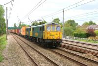 Bringing a little colour to the scene, 86604 and 86613 haul the Coatbridge to Crewe (4M74) Freightliner service on the Up Slow line at Euxton on the evening of 2 June 2015.<br><br>[John McIntyre&nbsp;02/06/2015]