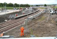 Activity at Shawfair station on 3 June 2015 centres around fencing and platform 'furniture'. View south towards Sheriffhall.<br><br>[John Furnevel&nbsp;03/06/2015]