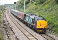 DRS EE Type 3 37402 leads the 0515 Carlisle to Preston (via Barrow) service through Hest Bank on 5th June 2015. 37609 was bringing up the rear on this leg of the diagram. <br><br>[Mark Bartlett&nbsp;05/06/2015]