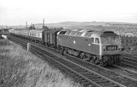 With only four Mk 1 coaches and a Southern Railway PMV in tow, Brush Type 4 No. 1513 is already making good speed following the Berwick stop as it passes through Tweedmouth in 1970. The train is the 14:15 Edinburgh to Newcastle semi-fast, or perhaps semi-slow as it had already taken 90 minutes to get this far! The rear end of the 09:20 York to Edinburgh parcels, which had passed two minutes previously [see image 50958], can just be discerned on the Royal Border Bridge.<br><br>[Bill Jamieson&nbsp;19/09/1970]