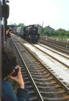 Photograph taken from a carriage window of <I>Scottish Grand Tour no 5</I> on the WCML near Carnforth on 1 June 1968. Lostock Hall Black 5 44942 is approaching from the south with a parcels train.<br><br>[John Robin&nbsp;01/06/1968]