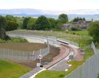 The Borders Railway crossing Hardengreen Viaduct over the A7 on 3 June 2015. Photographed looking south towards Dalhousie Mains from the pedestrian footbridge near the new Eskbank station. <br><br>[John Furnevel&nbsp;03/06/2015]