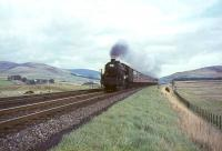 Black 5 44993 deputising for a diesel on a Glasgow - Manchester train in September 1964, photographed running to time north of Abington.<br><br>[John Robin&nbsp;26/09/1964]