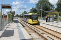 The first stop on the Manchester Airport tram line is Barlow Moor Road. Metrolink 3095, heading towards the city, leaves the Hardy Lane street running section and pulls in to the new station on 8th June 2015. <br><br>[Mark Bartlett&nbsp;08/06/2015]