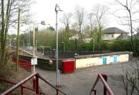 A quiet Sunday morning at Kirkhill in April 2007, seen here looking north west from the station entrance on Greenlees Road. The wide mezzanine level spanning the platforms once housed the booking office [see image 8051].<br><br>[John Furnevel&nbsp;15/04/2007]