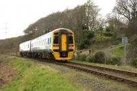 A mid-day service from Birmingham International to Pwlhelli accelerates up the gradient towards Minffordd on 13th April 2015.<br><br>[Colin McDonald&nbsp;13/04/2015]