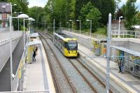 Metrolink 3066 calls at Burton Road in Didsbury with a service from Rochdale to East Didsbury. [See image 40061] from 2012 when this tram station and the East Didsbury line were still under construction. <br><br>[Mark Bartlett 08/06/2015]