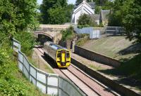 Another driver training run on the Borders Railway on a bright and sunny 9 June 2015. ScotRail 158869 heads south through the site of the 1847 Eskbank station, which eventually closed in 1969. The train will pass through its new 2015 replacement around half a mile further on.<br><br>[John Furnevel&nbsp;09/06/2015]