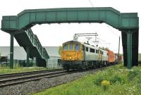 Freightliner 86604 and 86613 take the Coatbridge to Crewe containers under the footbridge at the site of Brock station on 2nd June 2015. Practically guaranteed to use a pair of 86s, this train is popular with photographers on summer evenings [See image 51533]. <br><br>[Mark Bartlett&nbsp;02/06/2015]