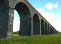 Not so much a viaduct, as a railway in the sky. [see image 51582] This structure was on the MR from Kettering to Manton Junction; whereas Seaton was on a cross-country LNWR route.<br><br>[Ken Strachan&nbsp;07/06/2015]