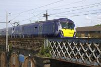 An Edinburgh - Helensburgh service crosses the bridge over Sandyford Street on its way to Partick on 9th June 2015. This stretch of line from Finnieston to Hyndland Junctions is very busy with up to 16 trains per hour each way at peak times.<br><br>[Colin McDonald&nbsp;09/06/2015]