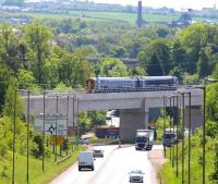 The 1052 Tweedbank - Newcraighall 2Z51 ScotRail 158 driver training trip crossing Hardengreen Viaduct on 11 June 2015 approximately 3 miles from its destination [see image 45688].<br><br>[John Furnevel&nbsp;11/06/2015]