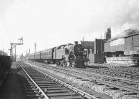 Fairburn tank 42196 leaving Stevenston on 4 April 1959 with an Ardrossan - Ayr train. <br><br>[G H Robin collection by courtesy of the Mitchell Library, Glasgow&nbsp;04/04/1959]