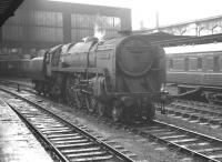 BR light Pacific 72009 <I>Clan Stewart</I> held on the centre road at Carlisle on a wet 17 August 1963. The locomotive is waiting to run north to Kingmoor shed after bringing in the 8am Aberdeen - Manchester (currently standing at platform 4). [See image 43696]<br><br>[K A Gray&nbsp;17/08/1963]
