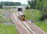 Having cleared the Edinburgh City Bypass, a ScotRail 158 heads south towards King's Gate points on the early afternoon of 15 June during a driver training run to Tweedbank. <br><br>[John Furnevel&nbsp;15/06/2015]