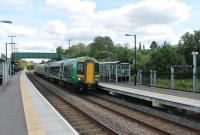 Opened in 2013, Stratford-upon-Avon Parkway still has a brand new feel about it two years later. 172337 makes its first stop on a London Midland Stratford-upon-Avon to Stourbridge Junction service on 15th June 2015. <br><br>[Mark Bartlett&nbsp;15/06/2015]