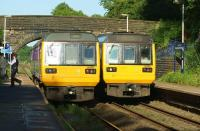 Blackpool South to Colne meets Colne to Blackpool South! 142005 and 142055 call at Pleasington station on 10 June 2015. Pleasington is a request stop but both services had passengers to drop off and collect on this occasion.<br><br>[John McIntyre&nbsp;10/06/2015]