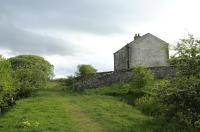 Two long-abandoned railway cottages standing alongside the trackbed of the SDLUR just east of the quarry and viaduct at Smardale Gill. View west on 8 May 2015.<br><br>[Brian Taylor&nbsp;08/05/2015]
