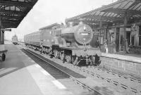 An Ardrossan Winton Pier - Kilmarnock stopping train, recently arrived at Irvine on 24 September 1949. Locomotive in charge is Hurlford shed's 2P 4-4-0 no 40644. Standing on the down line in the background is St Rollox based ex-Caledonian 0-6-0 no 57557.    <br><br>[G H Robin collection by courtesy of the Mitchell Library, Glasgow&nbsp;24/09/1949]