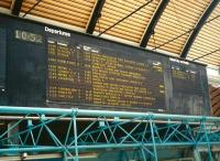 Nowadays, visual departure information at stations is standardised with almost all coming from the same company, infotec.co.uk. In the past though there was more variety. This board at Newcastle Central in June 1997 is electro-mechanical dot-matrix, with no light source of its own and reads along the way, rather than 'menu-style' which is now the norm. The method of denoting buffet and restaurant services using number of blocks seems a little eccentric. Wouldn't it have been clearer just to say 'BUFFET' or 'RESTAURANT'?<br><br>[David Panton&nbsp;19/06/1997]