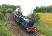Jubilee no. 45690 <I>Leander</I> climbs the bank from Farington Curve Jct with <I>The Fellsman</I> railtour from Lancaster to Carlisle on 17 June 2015. The locomotive is working hard as it approaches Coote Lane road bridge with 11 coaches and a Class 47 on the rear.<br><br>[John McIntyre&nbsp;17/06/2015]