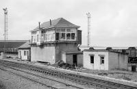 A passing shot of Falkland Junction Signal Box on 31 August 1985. It had closed on 7 April that year as part of the Ayrshire electrification project. Taken on the occasion of a BR Ayr Open Day, with various specials laid on.<br><br>[Bill Roberton&nbsp;31/08/1985]