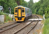 Northern 158752 crosses Hoghton level crossing heading west on 17 June 2015 with a York - Blackpool service.<br><br>[John McIntyre&nbsp;17/06/2015]