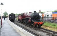 Platform scene at Heywood on the East Lancs Railway on 20 June 2015 with LMS Hughes <I>Crab</I> 13065 in the process of running round its train.<br><br>[Peter Todd&nbsp;20/06/2015]