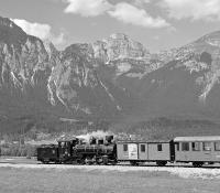 Against an impressive backdrop of the Rofangebirge, Zillertalbahn No. 4 rolls away from Strass im Zillertal towards Jenbach on the early afternoon steam working from Mayrhofen. At that time, two daily return services were being run during the peak season but this has now been reduced to one, rather limiting the photographic possibilities on the line. The remaining return working now takes place in the late afternoon so that the lighting is no longer optimal for this shot.<br><br>[Bill Jamieson&nbsp;05/09/2005]