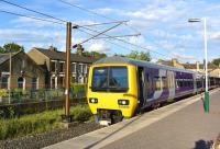 Northern Rail EMU 323230 about to leave Glossop Station on the evening of 20 June bound for Manchester Piccadilly.<br><br>[Peter Todd&nbsp;20/06/2015]
