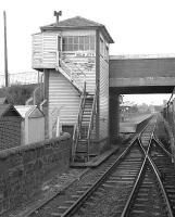 The signal box at Holm Junction, photographed from a passing train on 31 August 1985. Ardrossan South Beach station is on the other side of the bridge carrying South Beach Road.  <br><br>[Bill Roberton&nbsp;31/08/1985]