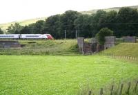 A northbound Pendolino approaching Crawford on the WCML in August 2009. The train is passing the site of the yard that once acted as an interchange point with the 3 ft gauge Camps Railway (built to facilitate the construction of Camps Reservoir). View is south towards the bridge which took the NG line across the River Clyde.<br><br>[John Furnevel&nbsp;05/08/2009]