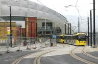 Double tram tracks are in place again from Shudehill through Manchester Victoria, while at the new side entrance two further tracks are being laid for the <I>Second City Crossing</I>. A double tram led by 3036 climbs Balloon St on 25th June heading for Shudehill as a further double set passes through Victoria bound for Bury.  <br><br>[Mark Bartlett&nbsp;25/06/2015]