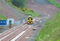 A ScotRail 158 involved in driver training duty on 26 June 2015. The train is in the process of running north through the points at Tynehead and entering the double track section to Fushiebridge.<br><br>[John Furnevel&nbsp;26/06/2015]