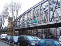 A Bombardier & Alstom built MF2000 (MF01) EMU runs east across the substantial girder bridge along Boulevard de la Chapelle on 26 February, shortly after leaving La Chapelle station on the elevated Paris Metro Line 2 [see image 50492]. This is a case of rail over road over rail, as below the road, running left to right, are the approach tracks running into Gare de l'Est station located a short distance to the right.<br><br>[David Pesterfield&nbsp;26/02/2015]