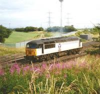 The Cockenzie branch lost its raison d'etre in 2013 when the coal-fired power station was closed. Back in July 1995 Transrail liveried 56072 is seen here returning to the main line after working the branch.<br> <br><br>[David Panton&nbsp;19/07/1995]