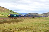 DRS 68001 <I>Evolution</I> races south on the long straight section north of Dalwhinnie on 20 June 2015 with a train of eighteen empty containers bound for Mossend Yard.<br><br>[John Gray&nbsp;20/06/2015]